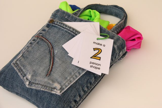 Handmade Shape Stretchies placed within a jean pocket bag with activity cards.