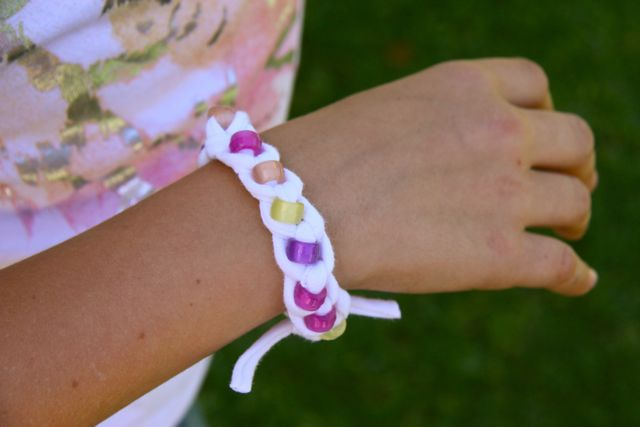 Beaded T-shirt Bracelet in the sun.  Look the beads changed colors.